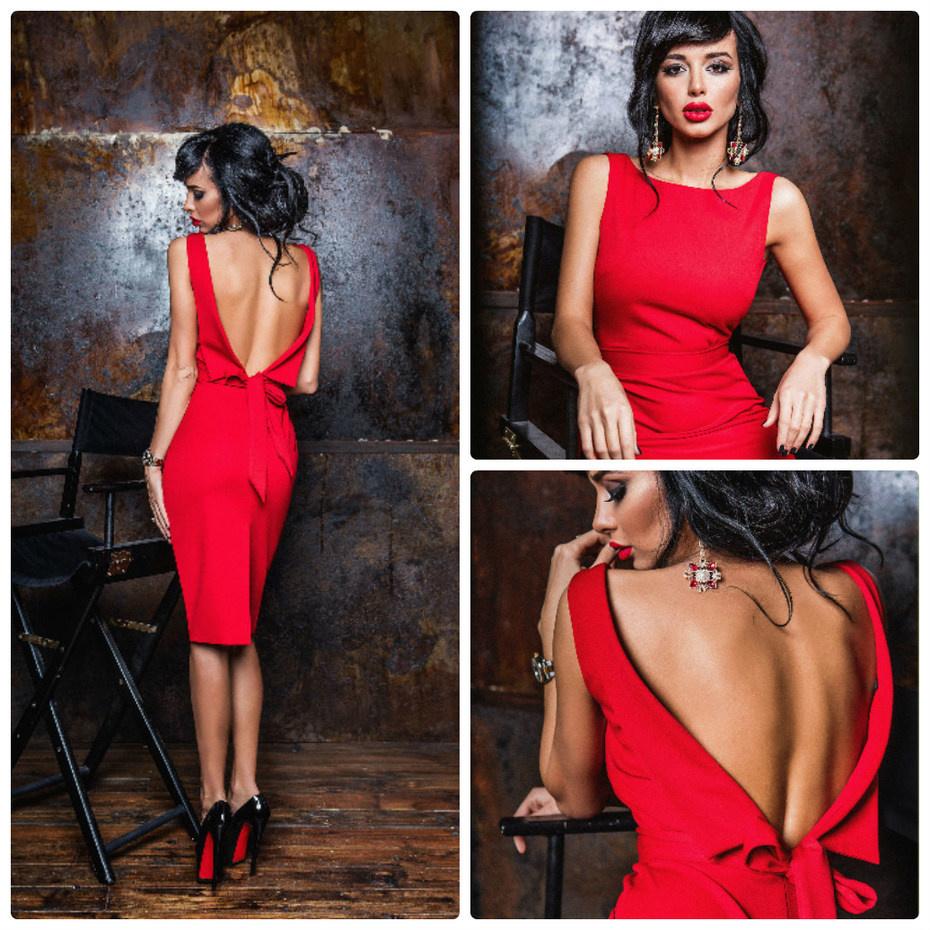 девушка в красном платье с открытой спиной